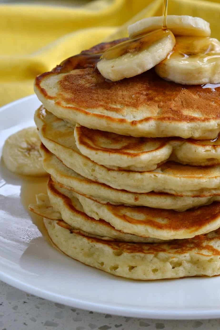 Get your banana fix with these homemade Banana Pancakes made with buttermilk, bananas, vanilla and a touch of cinnamon.