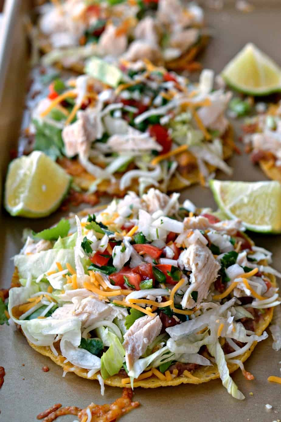 These easy Chicken Tostadas are a cinch to put together using ready to go tostada shells and rotisserie chicken.