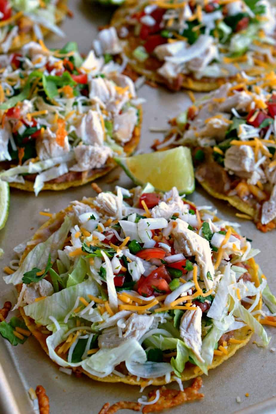 A five ingredient Pico de Gallo, refried beans, and Mexican Blend cheese take these chicken tostadas to the next level.