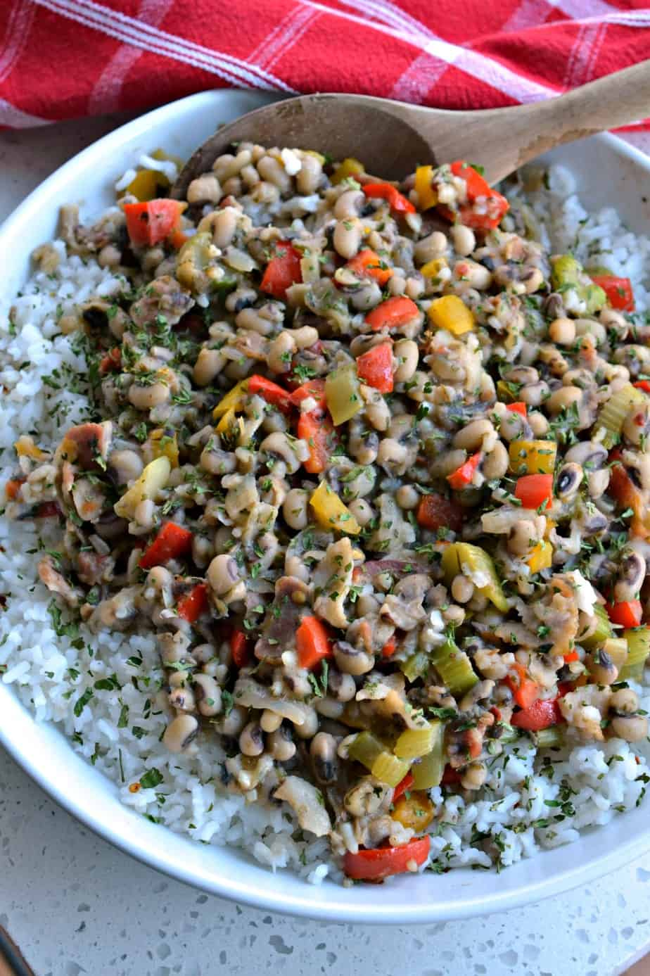 Hoppin' John is a Southern black eyed pea dish with bacon, onions, celery, bell peppers and garlic served over white rice.