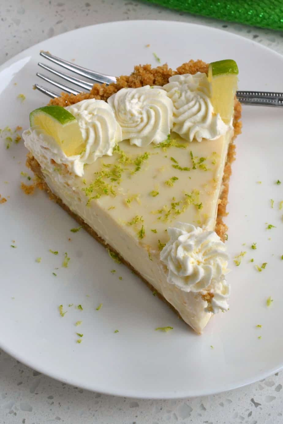 With a four ingredient crust and four ingredient filling this key lime pie comes together quickly and easily.