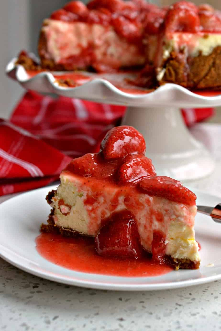 Delectable Strawberry Cheesecake is a cinch to make with a three ingredient graham cracker crust and fresh strawberry sauce.