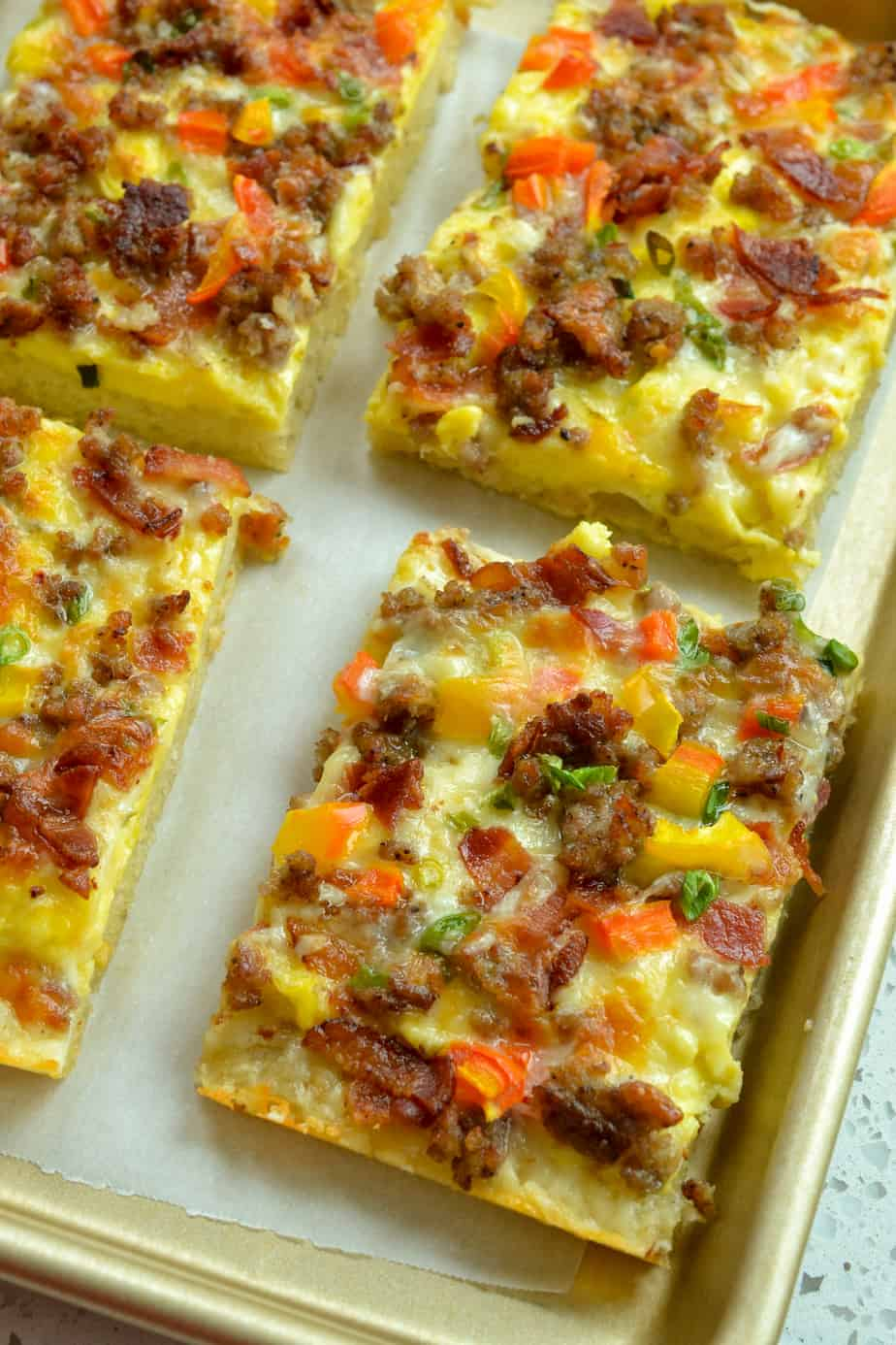 Tasty Breakfast Pizza combines crispy bacon, sausage, sweet peppers, green onions and cheese on a fresh baked pizza crust.