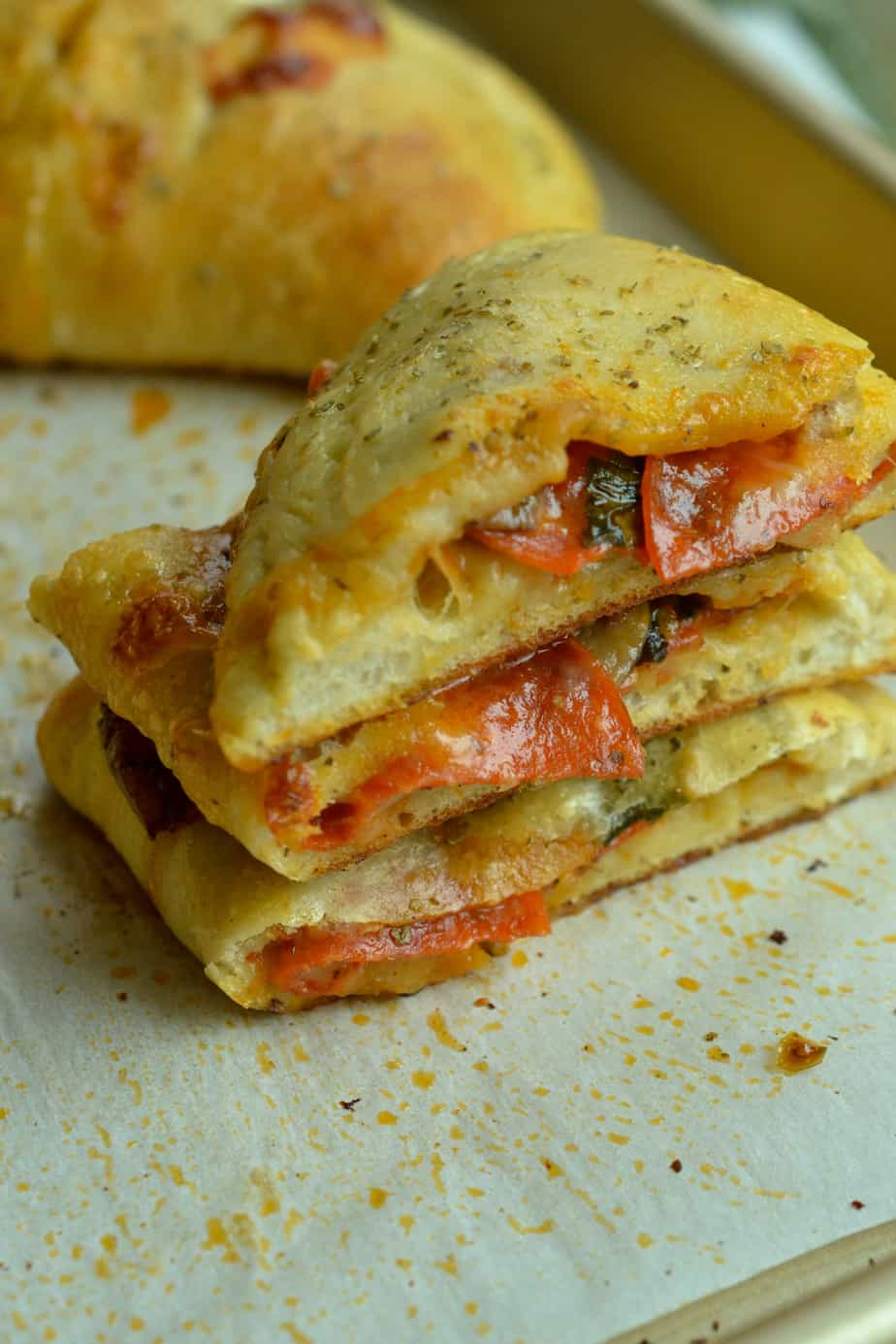 A delectable and easy Calzone recipe using homemade pizza dough, mozzarella, pepperoni and your favorite vegetables.
