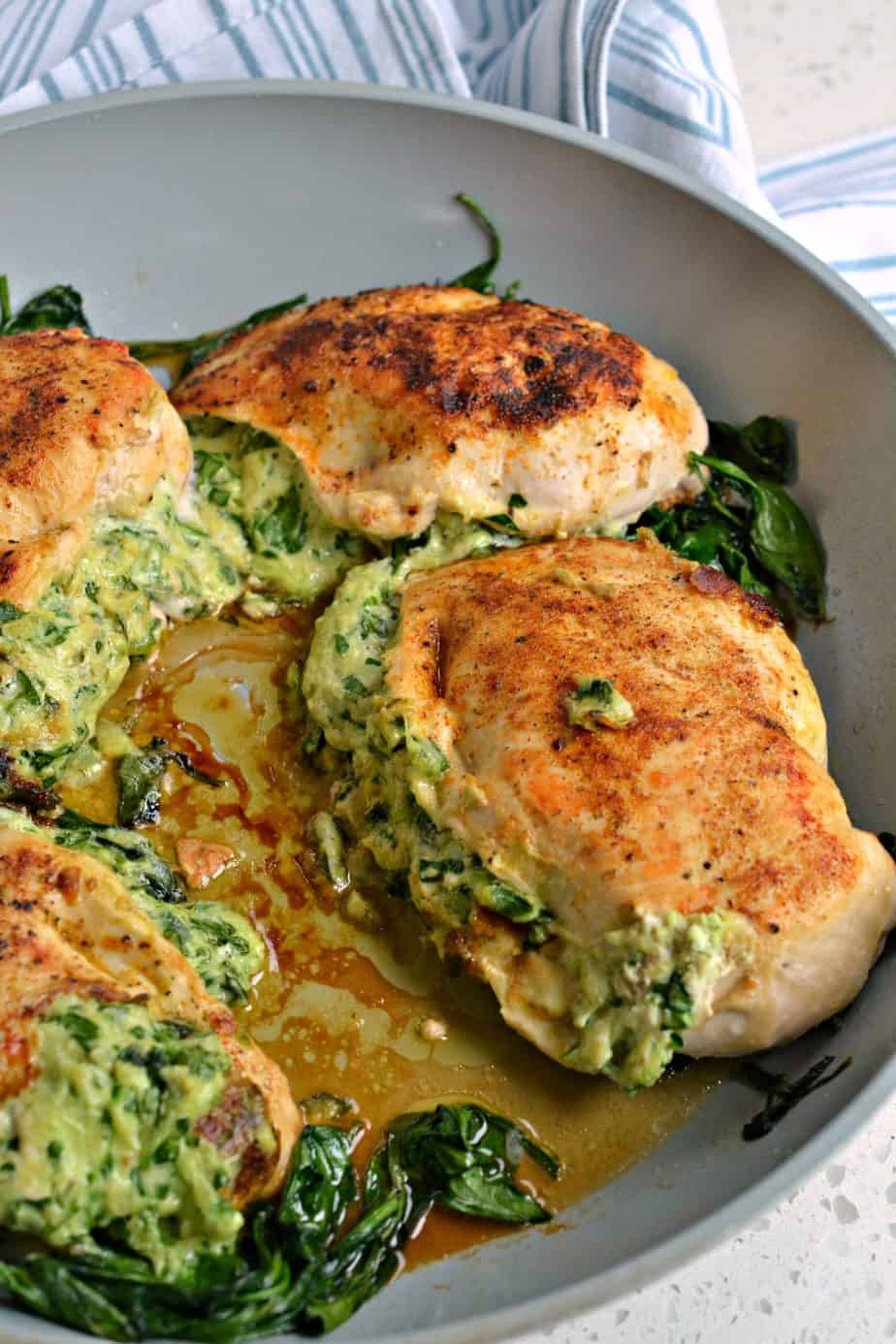 This Spinach Stuffed Chicken is a delicious combination of chopped spinach, herb cream cheese, mozzarella, and Parmesan.