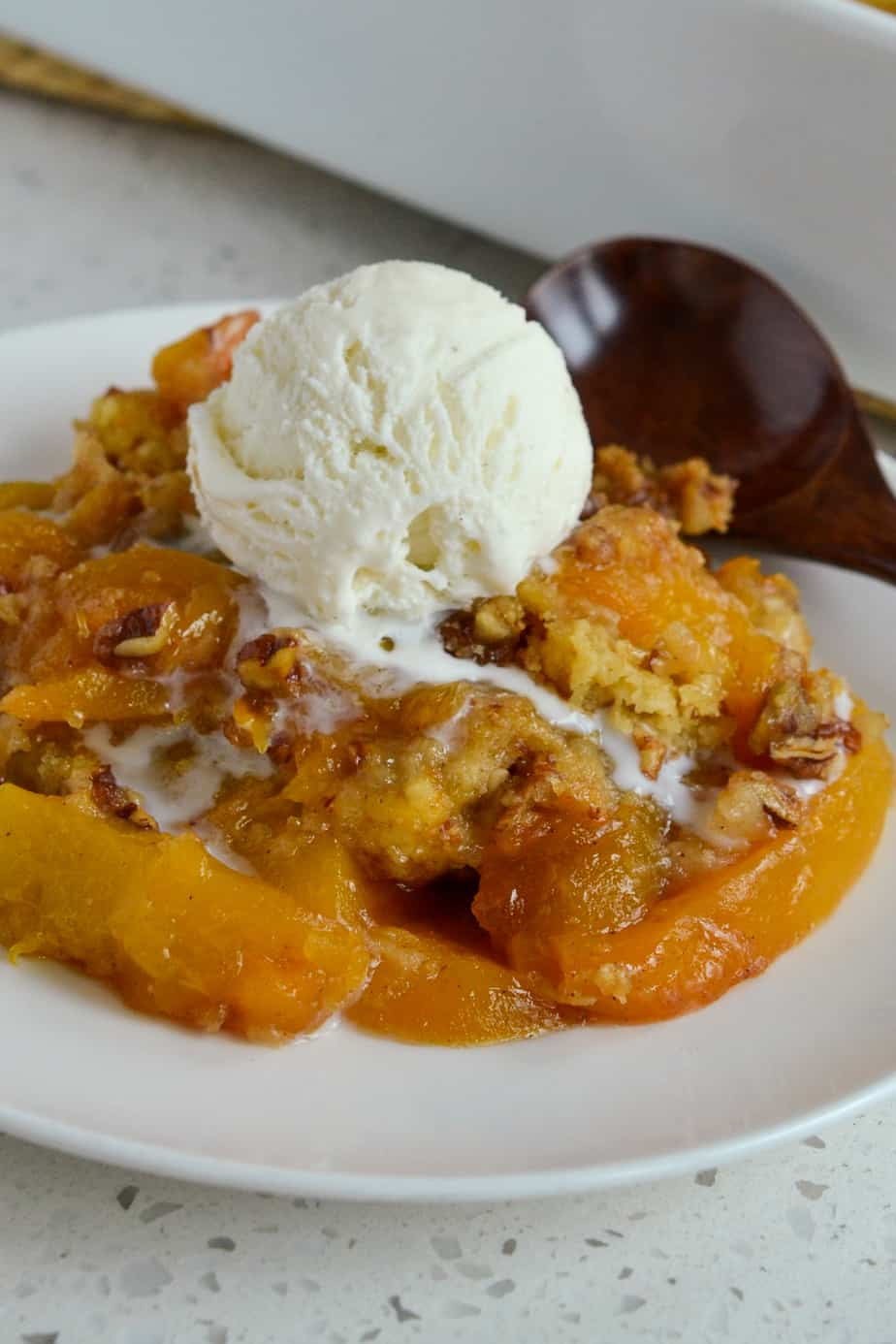 This scrumptious Peach Dump Cake is a cinch to make and always a hit at potlucks, family reunions and parties.