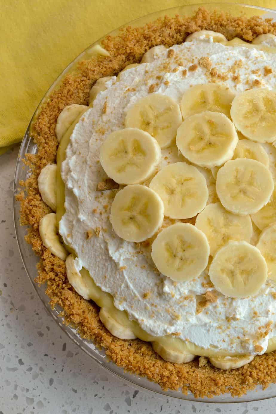 Creamy banana cream pie with a graham cracker crust and homemade vanilla pudding.