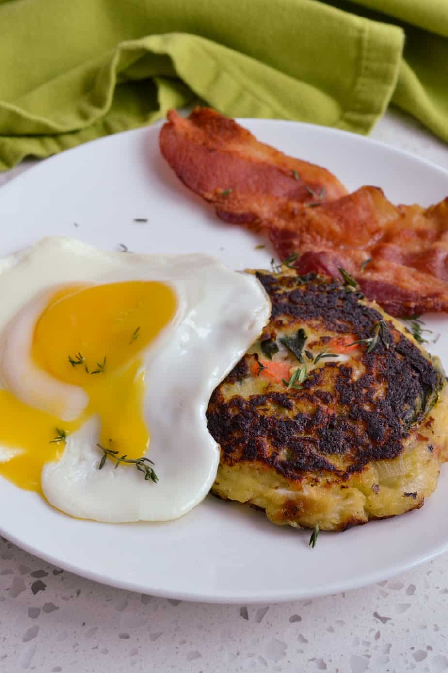 Top the potato pancakes with a sunny side up or poached egg.