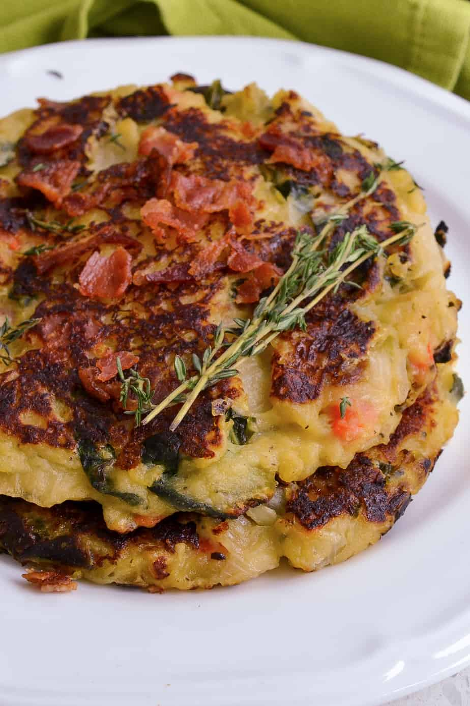 Delicious potato cakes made with cabbage, onions, carrots, collard greens and ham.