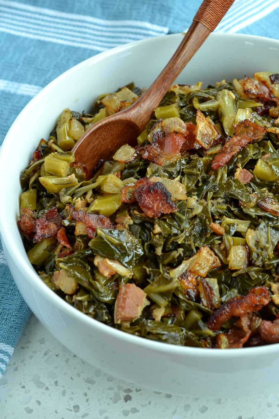 Southern greens slow cooked with bacon, onions, and garlic.
