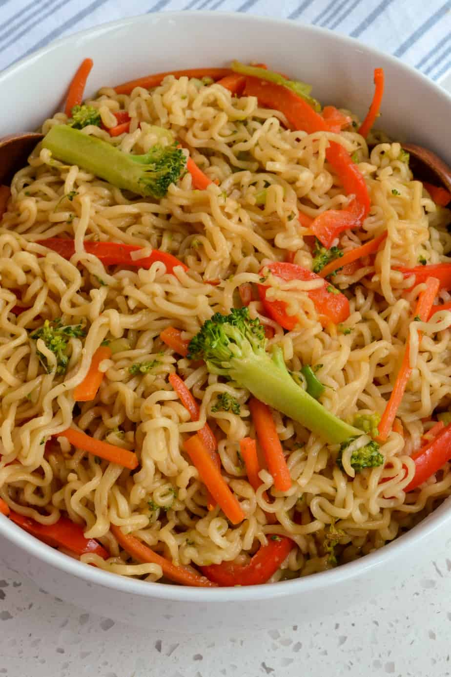 Noodle stir fry recipe with broccoli, red bell peppers, and carrots with an Asian sauce.