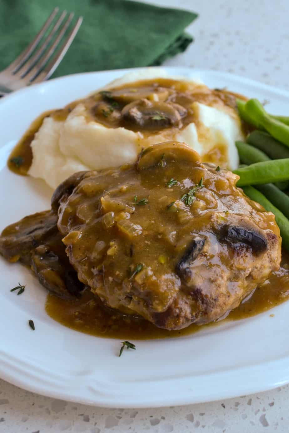 Tender beef patties with rich mushroom gravy.