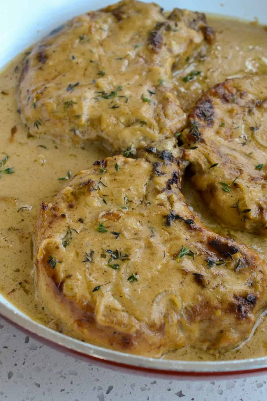 Pan fried pork chops smothered in gravy.