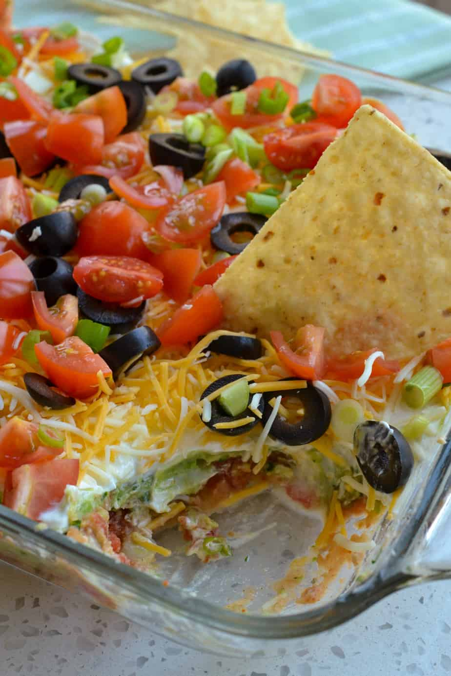 Enjoy this layer dip with tortilla chips.