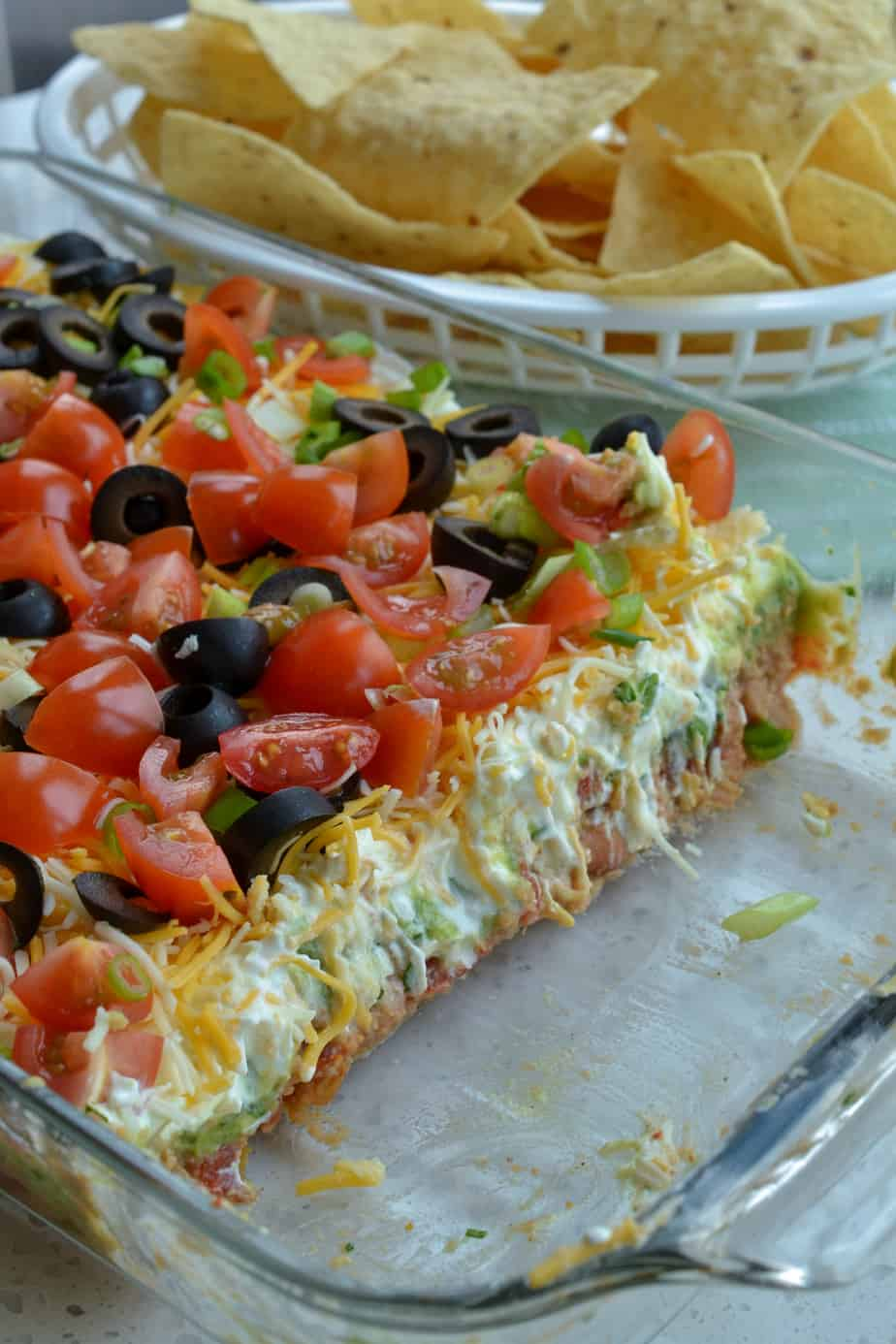 Not only is this Mexican dip delicious it is pretty.