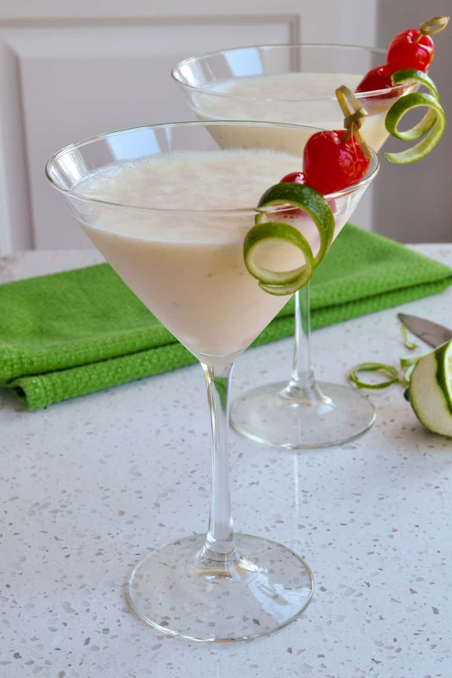 Rum, bananas, coconut milk, and ice are blended to make these cocktails.