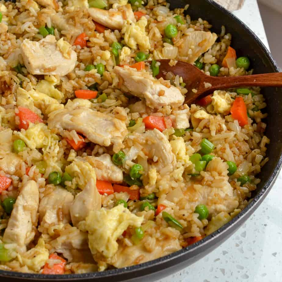 Peas, carrots, eggs, and chicken in skillet fried rice.