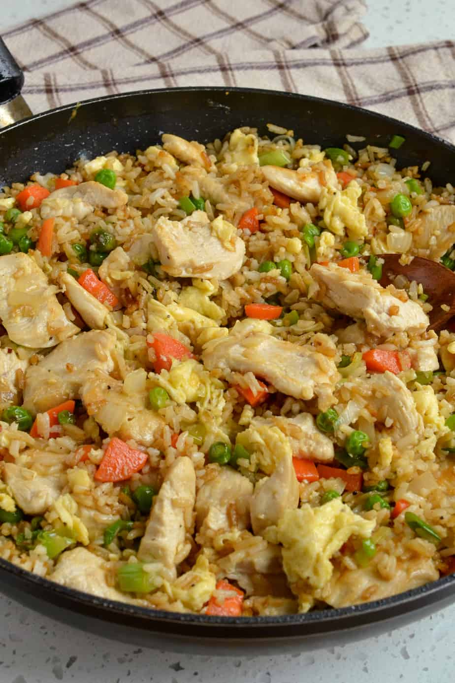 Chicken fried rice in a skillet.