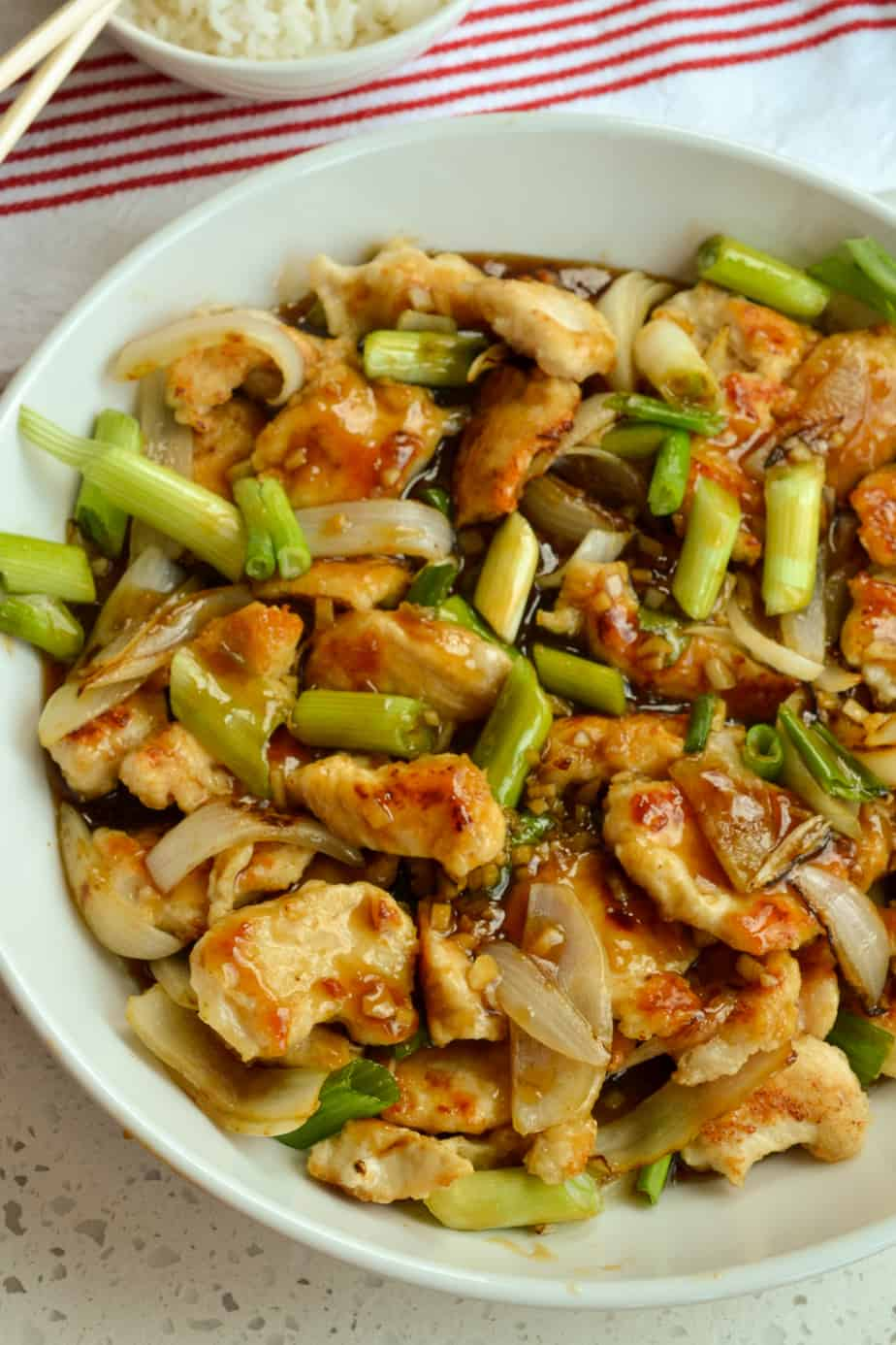 Bowl full of crispy chicken, sweet onions, scallions and mongolian sauce.