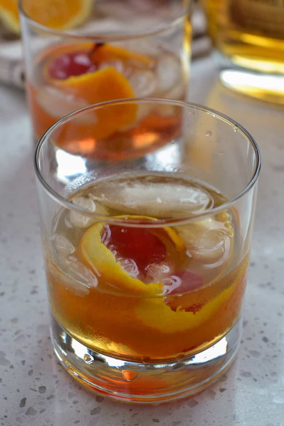 Old fashioned cocktail on ice