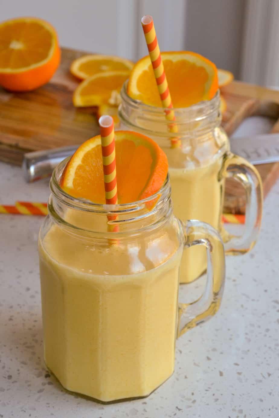 Mugs full of creamy frozen orange julius.