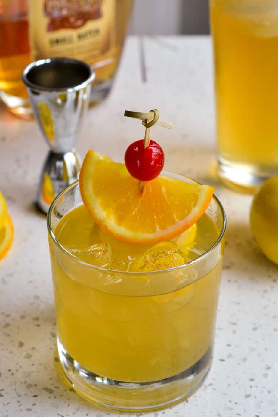Ice cold whiskey sour over ice with a garnish