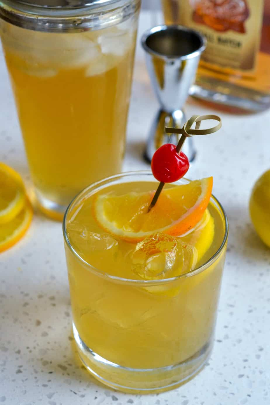 Bright lemon cocktail mixed in a cocktail shaker