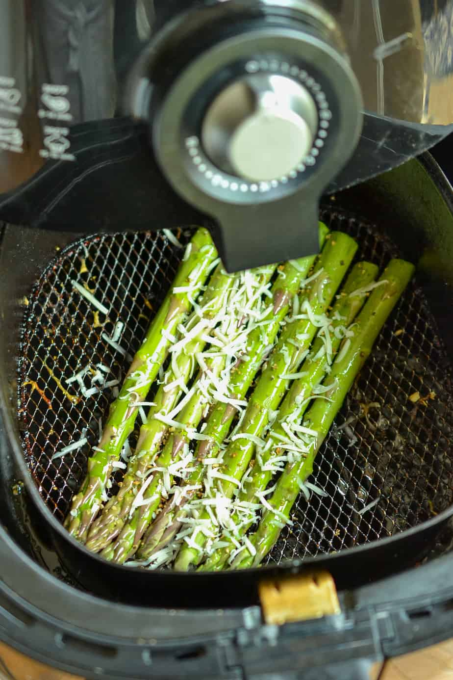 Lay the asparagus in a single layer in the basket of the air fryer.