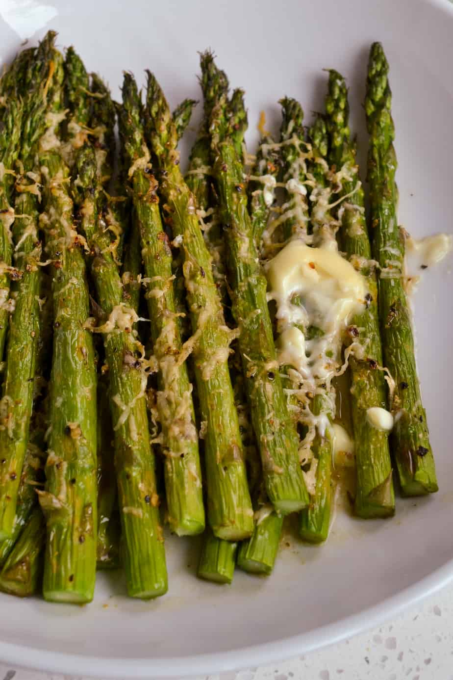Easy air fryer asparagus with Parmesan Cheese and butter.