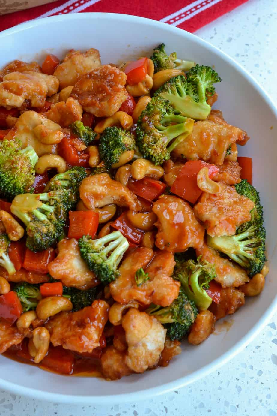 Cashew chicken with broccoli and red peppers.