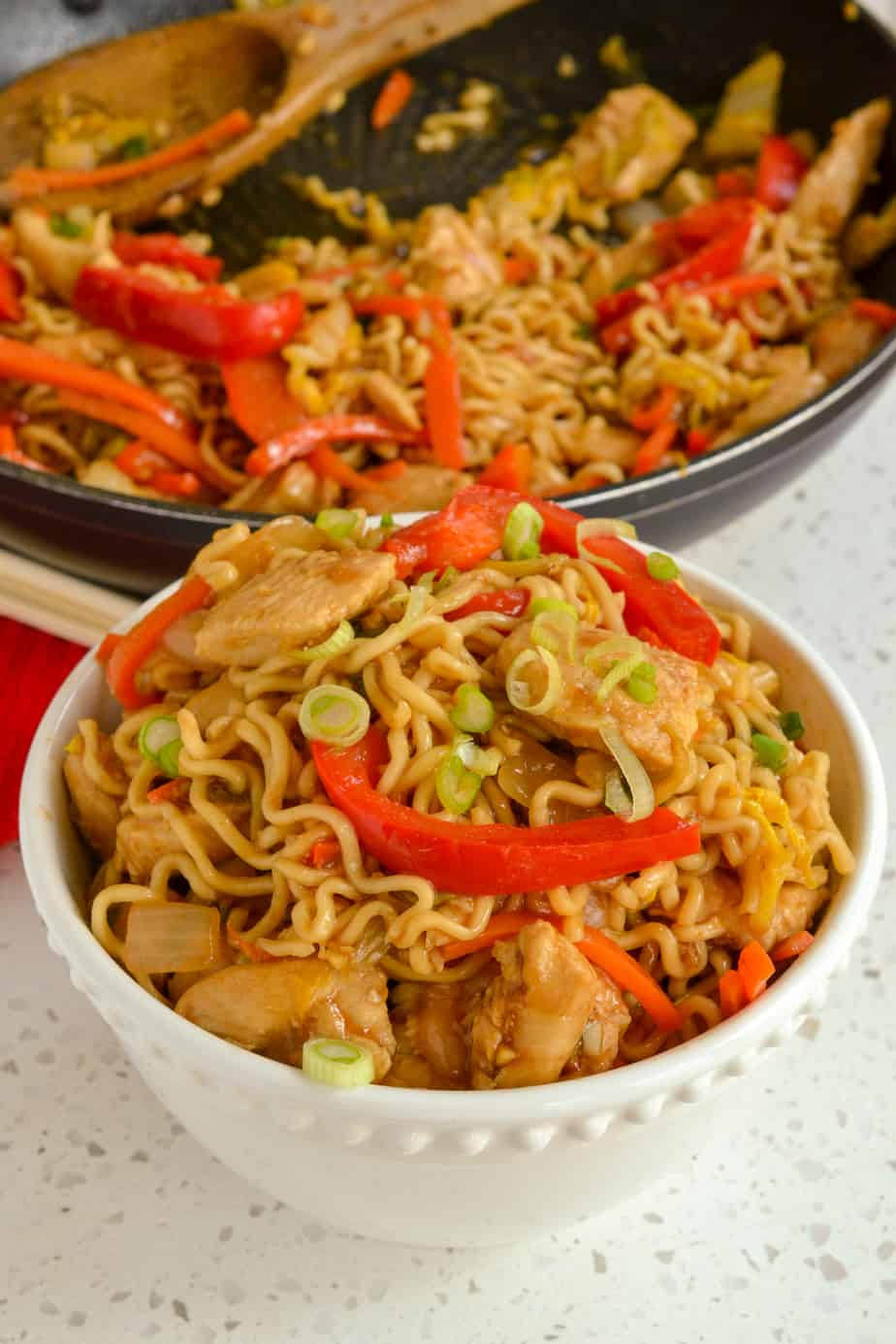 A bowl of chicken, vegetable and noodle stir fry.