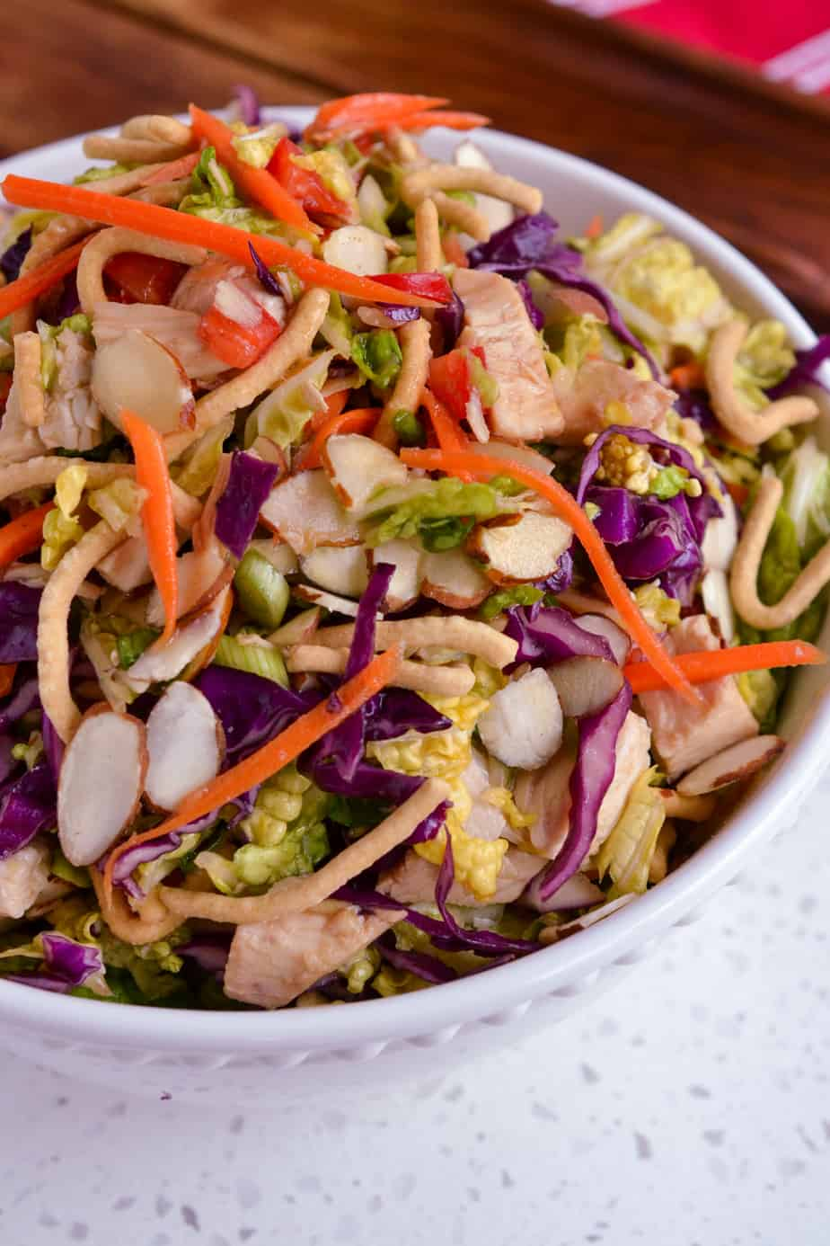 A bowl of Oriental Chicken Salad drizzled with an easy six ingredient Asian Dressing.