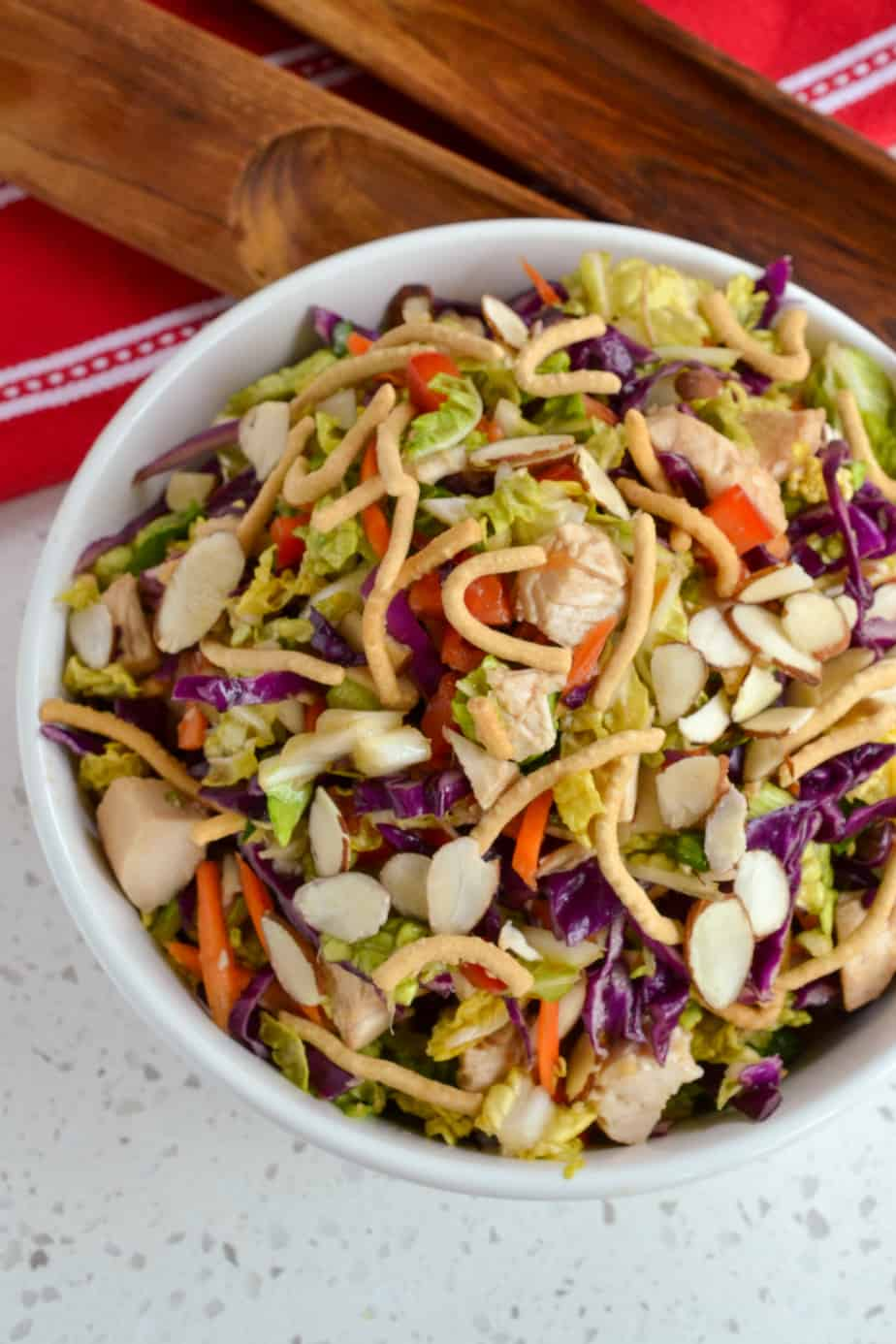 Oriental Chinese chicken salad with almonds, chow mein noodles, carrots, and red bell peppers.
