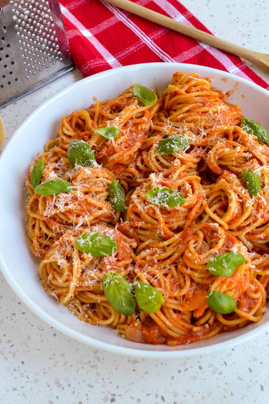 Pasta with tomato sauce topped with fresh basil and Parmesan Cheese
