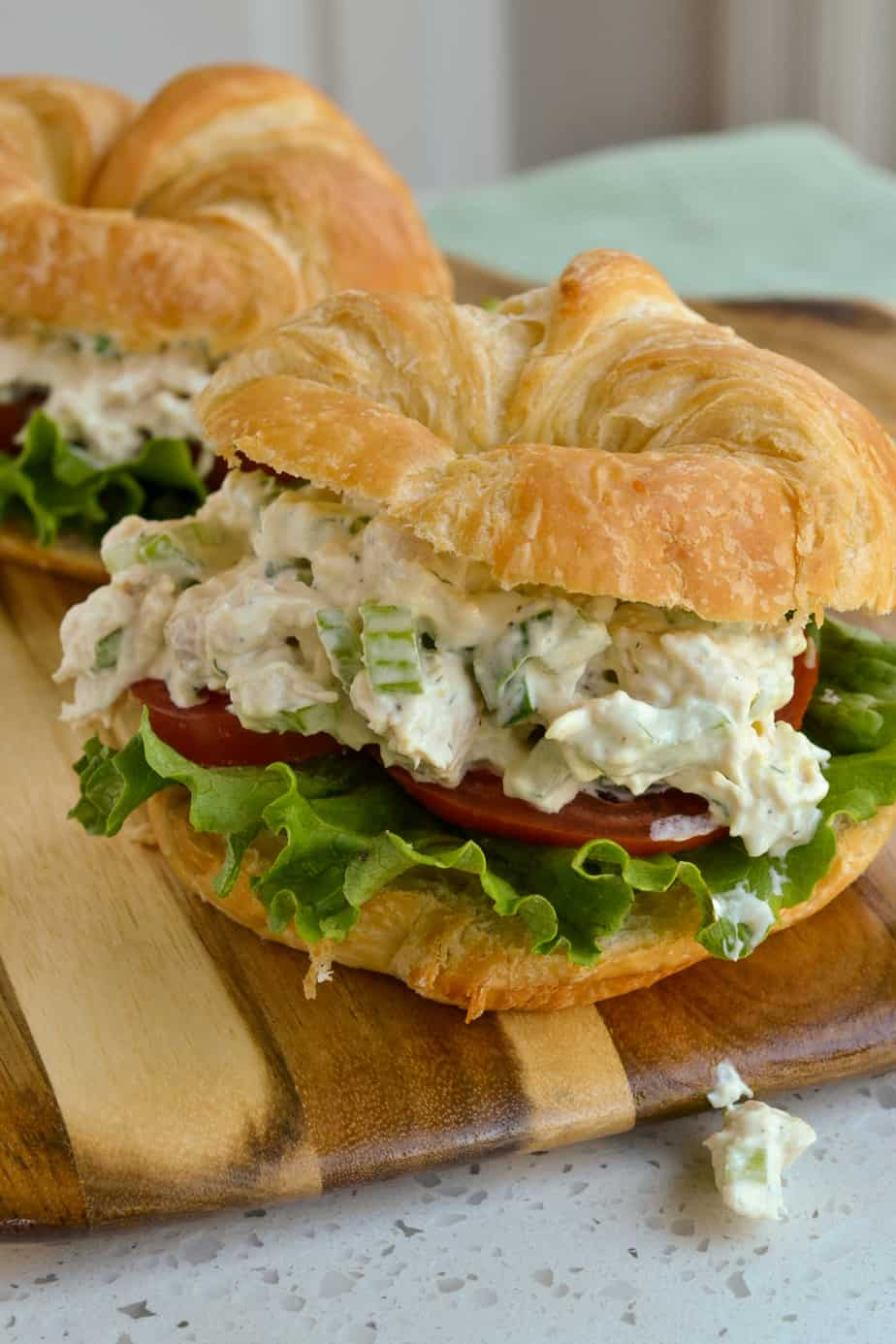 Rotisserie Chicken Salad on a croissant with lettuce and tomato.
