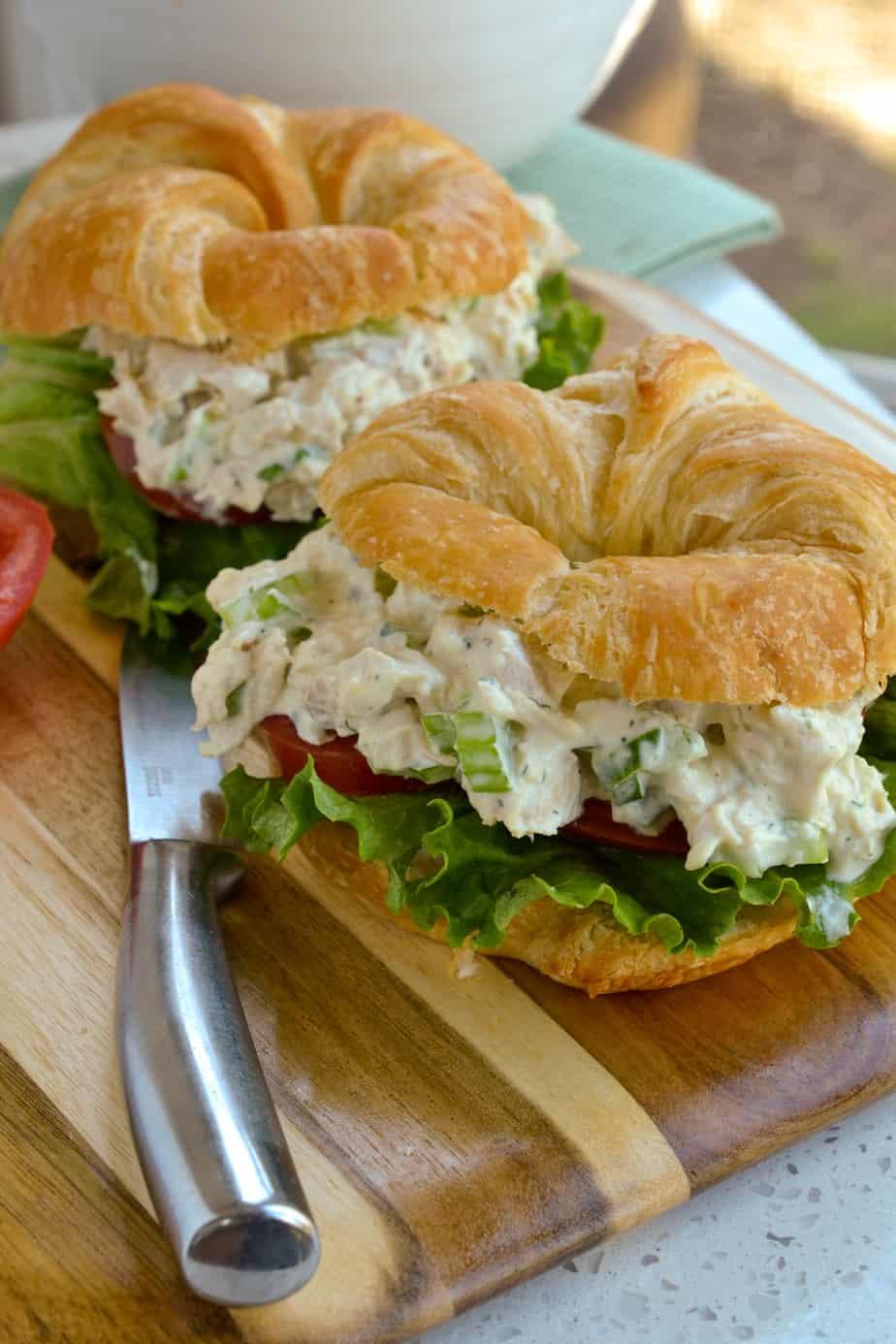 Creamy chicken salad on a croissant.