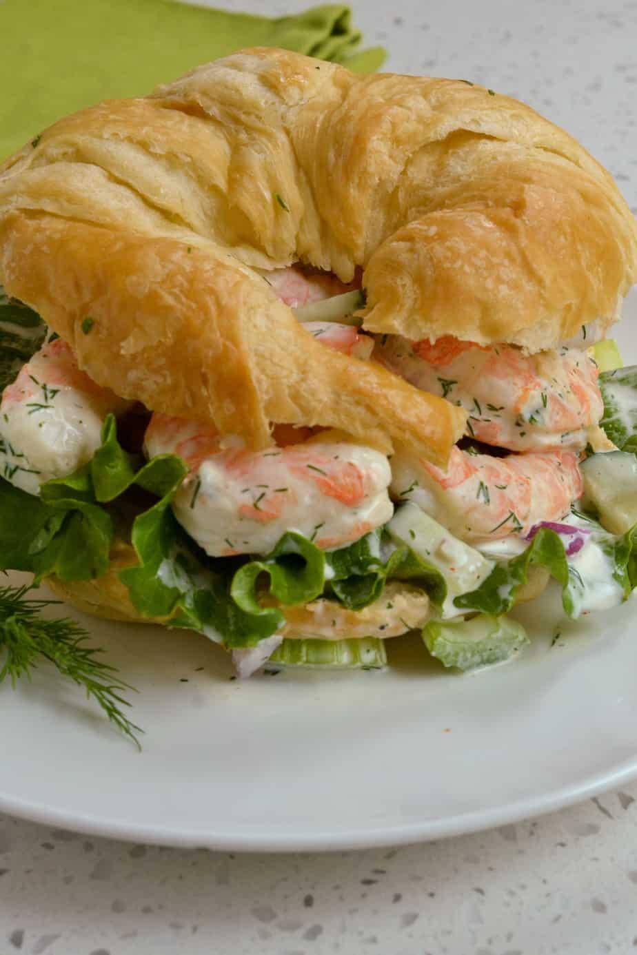 Shrimp salad on buttery croissant.