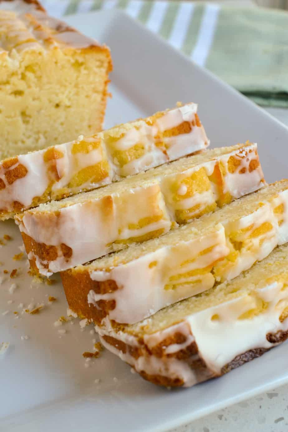 Slices of lemon glazed pound cake on a platter.