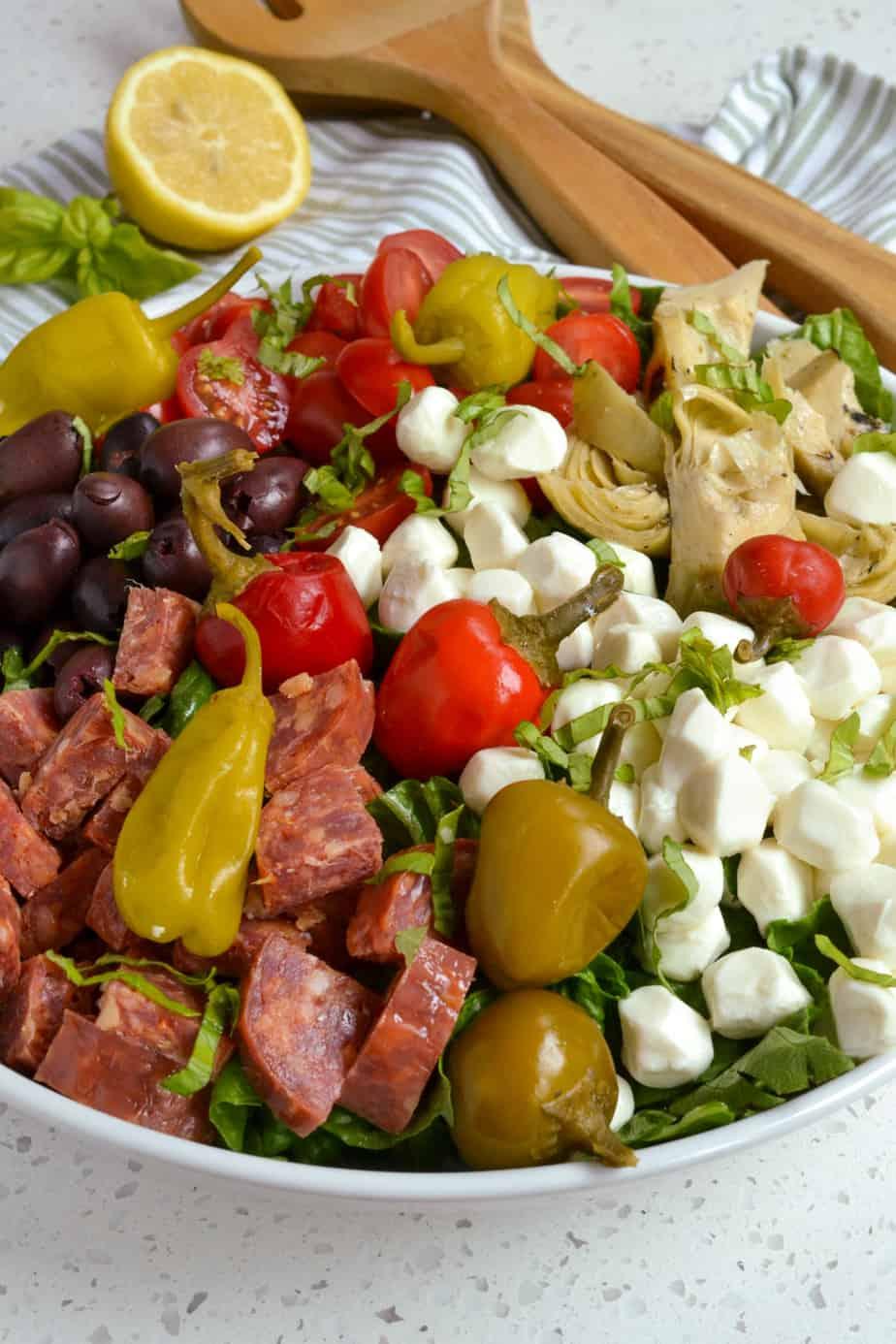 Italian salad with fresh mozzarella, salami, Kalamata olives, artichoke hearts, and peperoncini.
