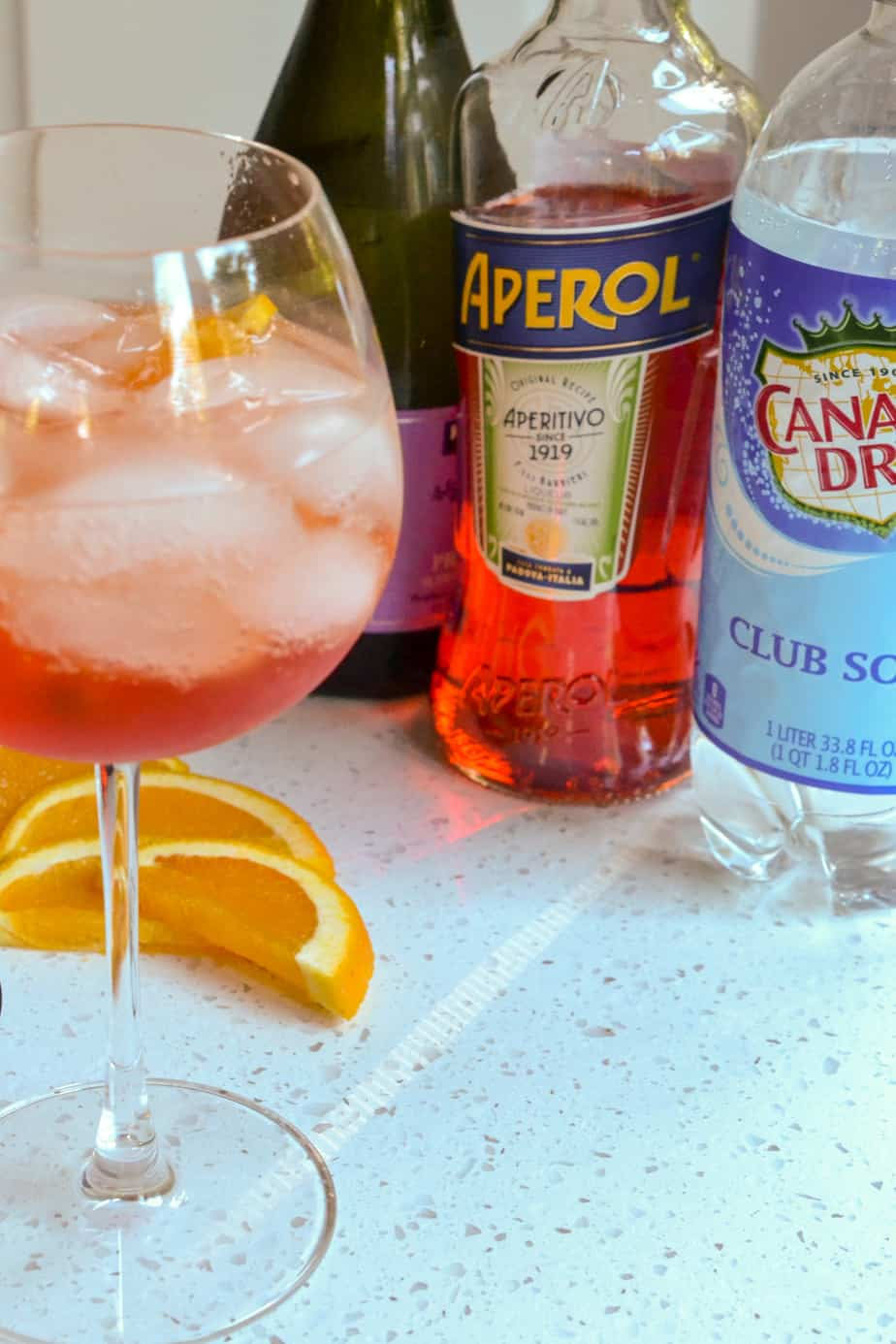 The ingredients for Aperol spritz are prosecco, Aperol, and club soda.