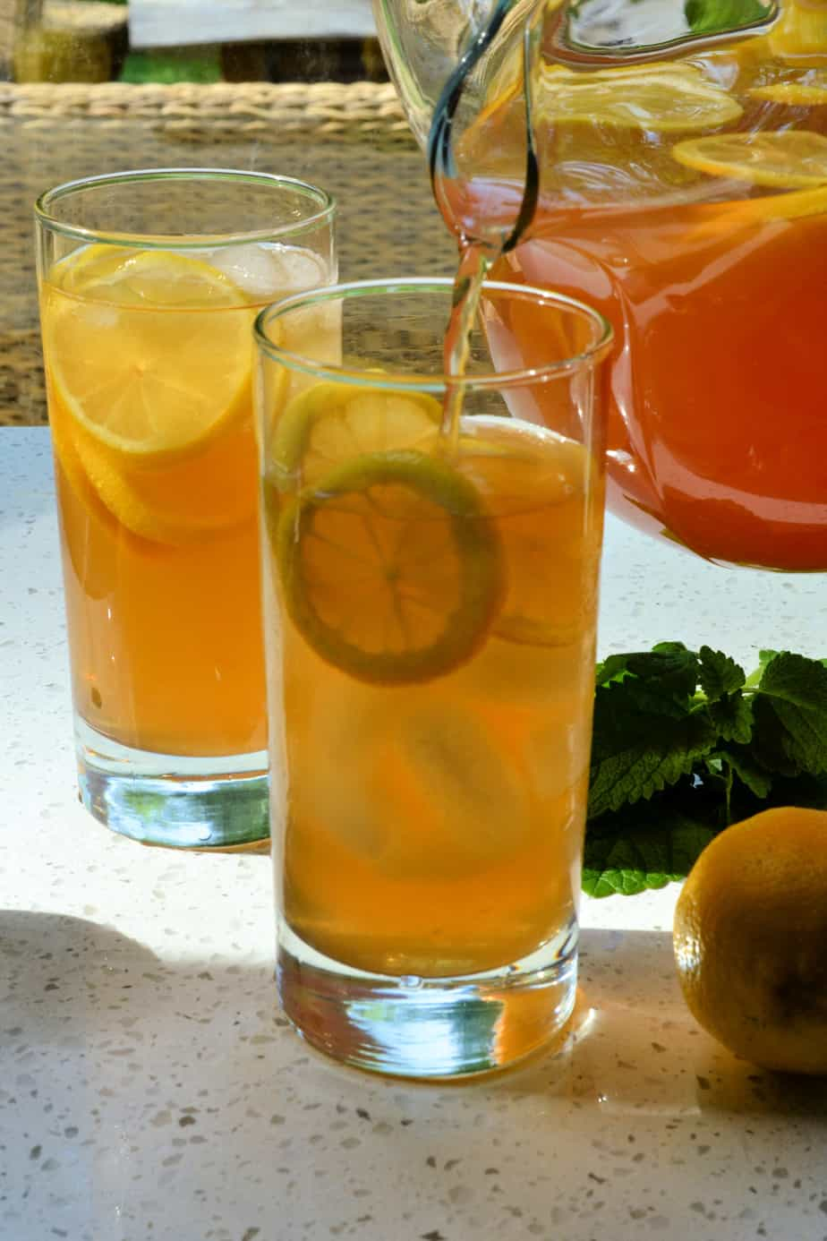 A pitcher of tea mixed with lemonade.
