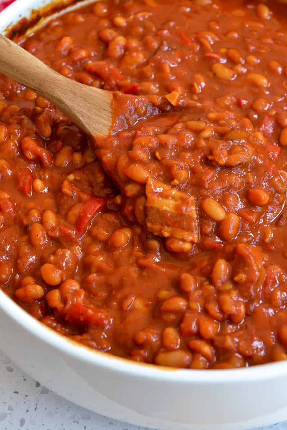 A spoon full of baked beans