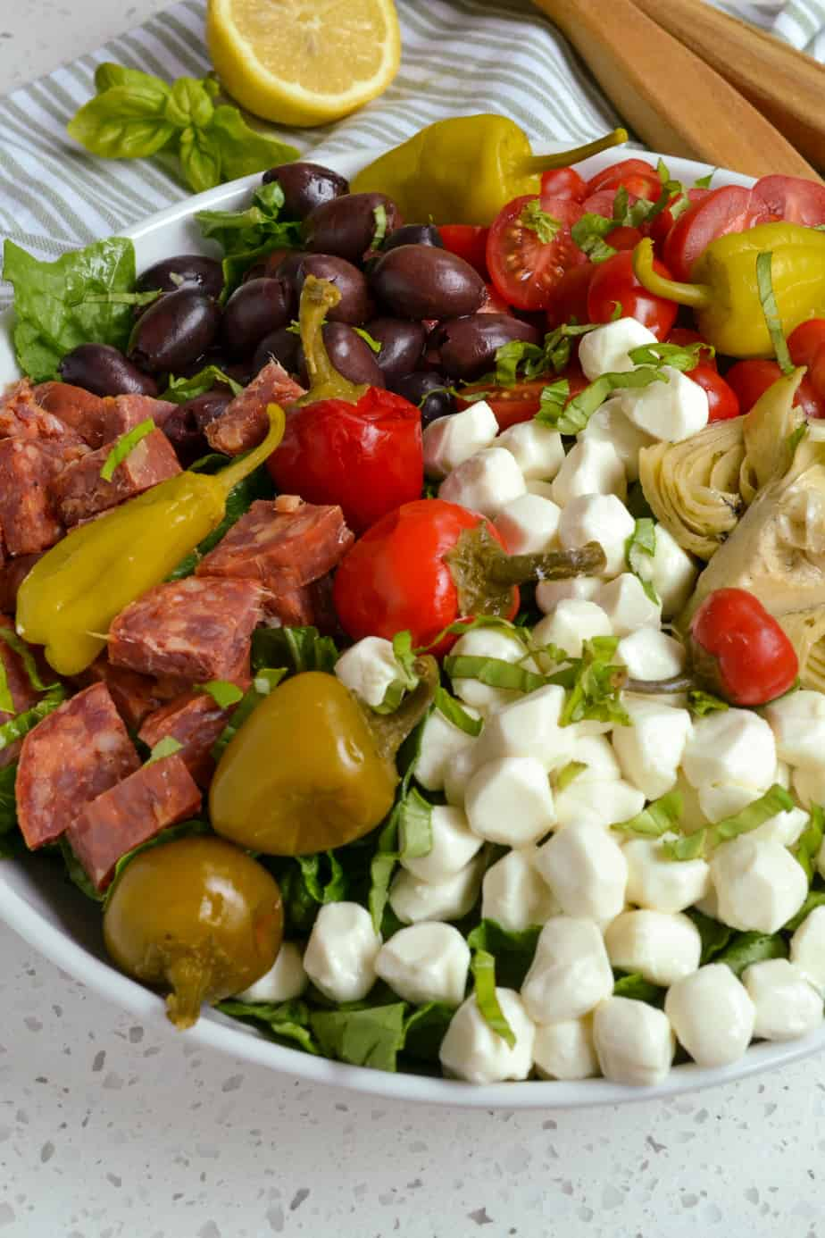 A close up view of antipasto salad in a bowl.