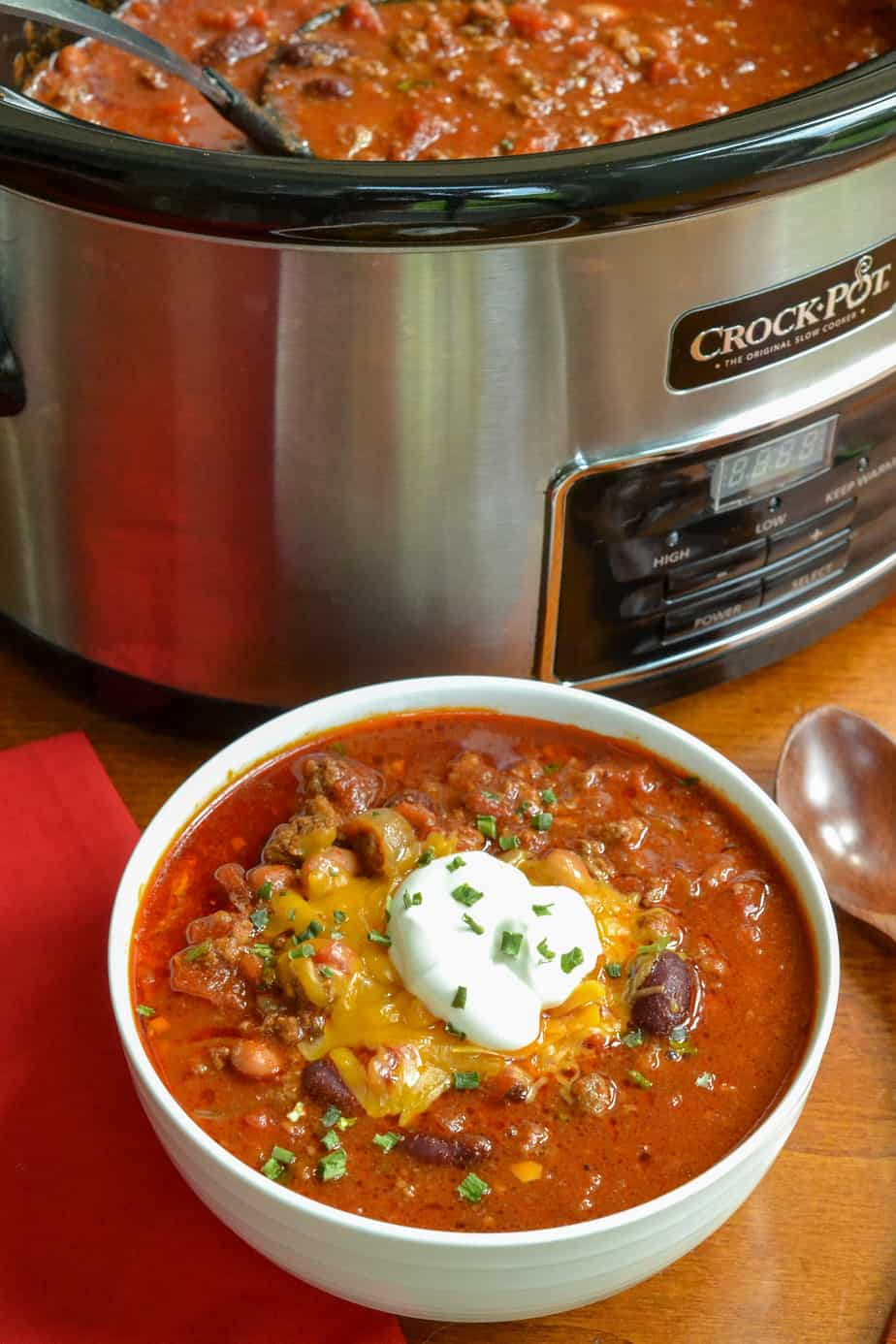 A crock and a bowl full of chili