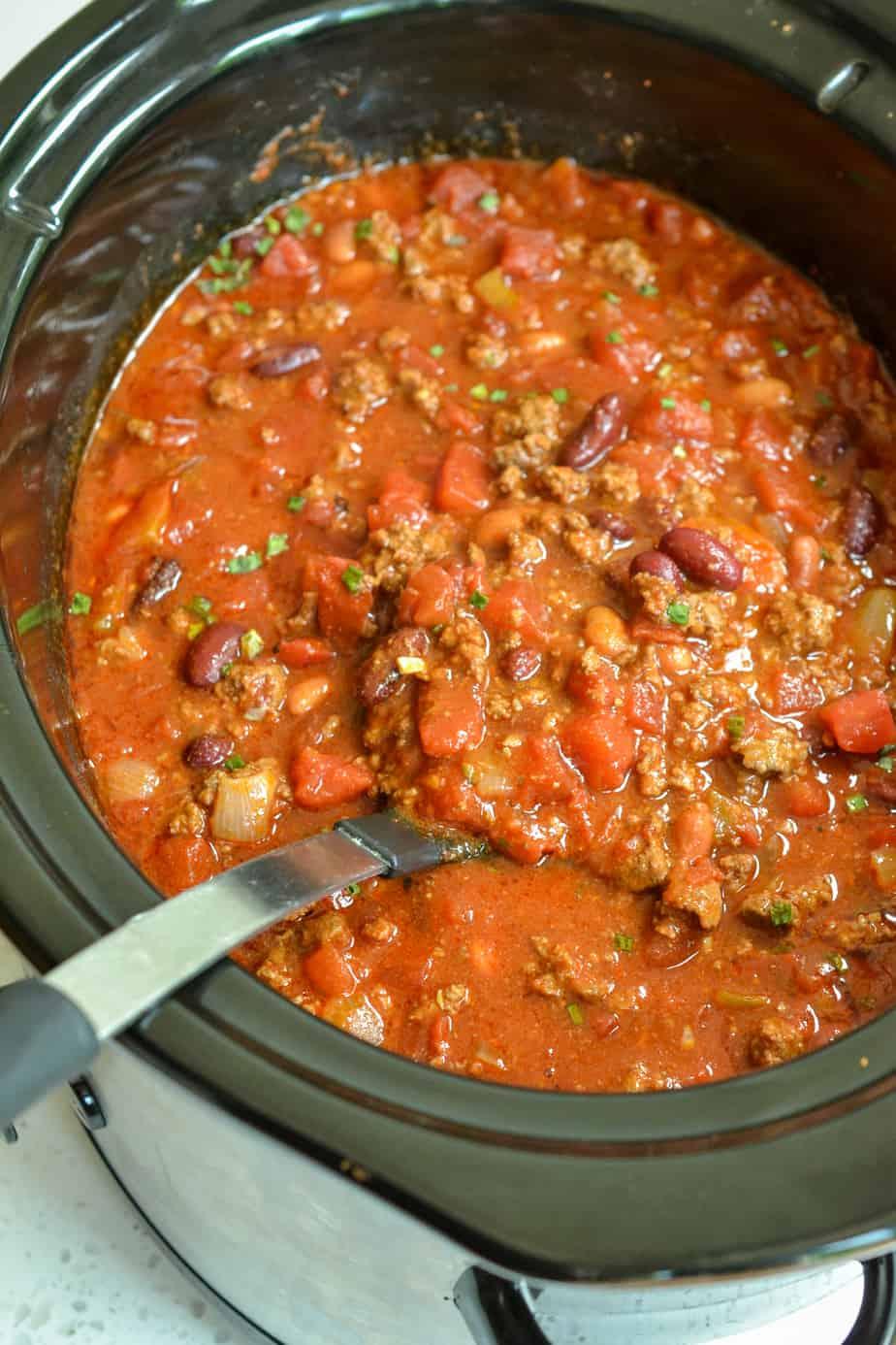 A large ladle full of chili.