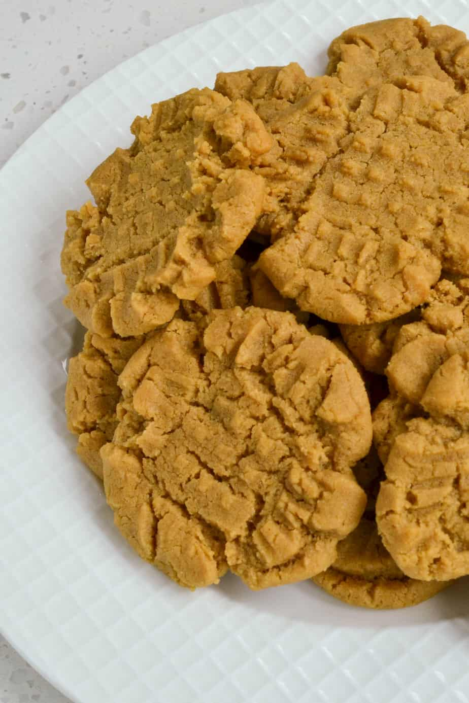 A plate full of peanut butter cookies