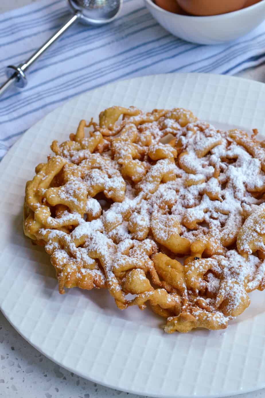 Funnel cake with powdered sugar.