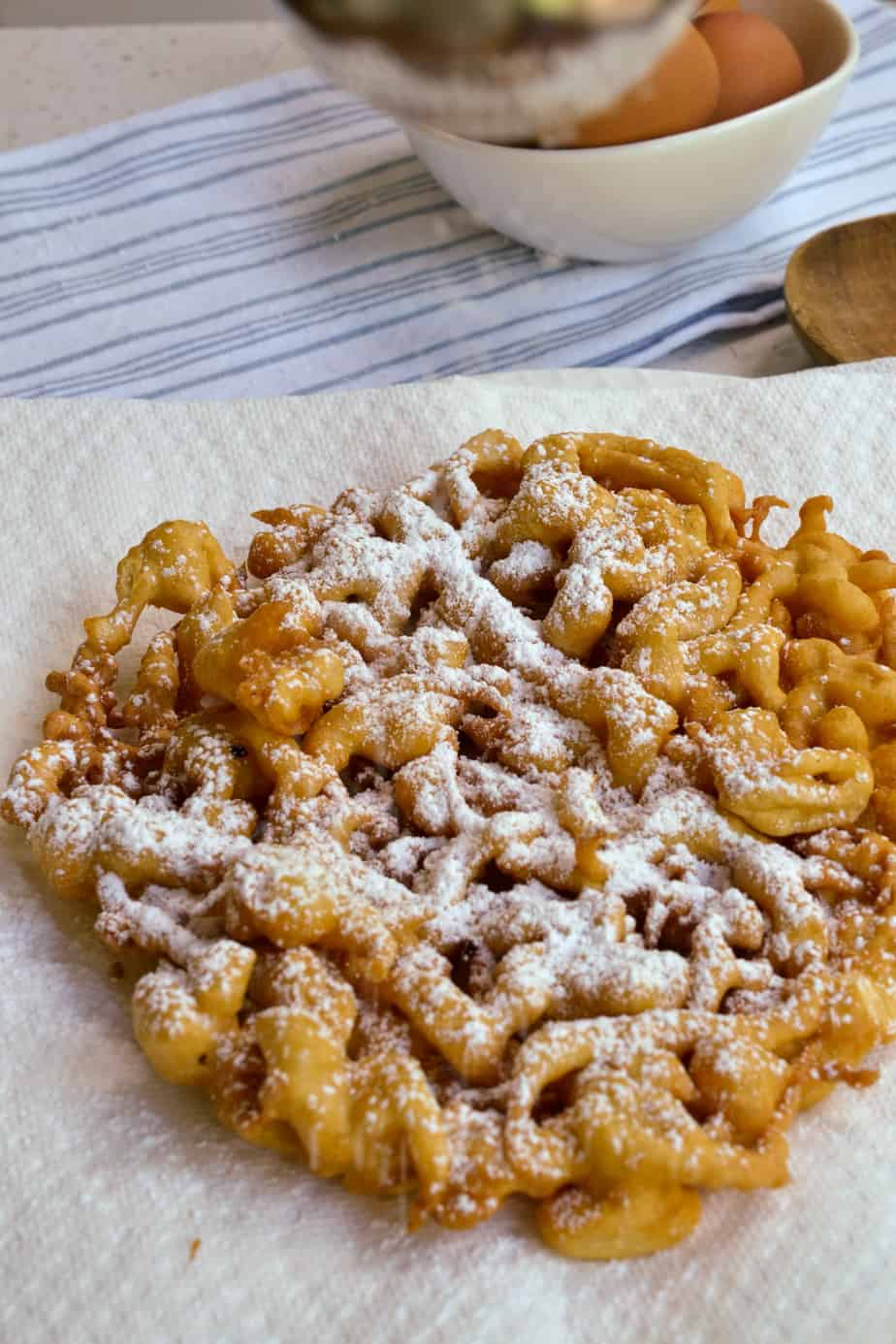 Homemade funnel cakes dusted with powdered sugar.