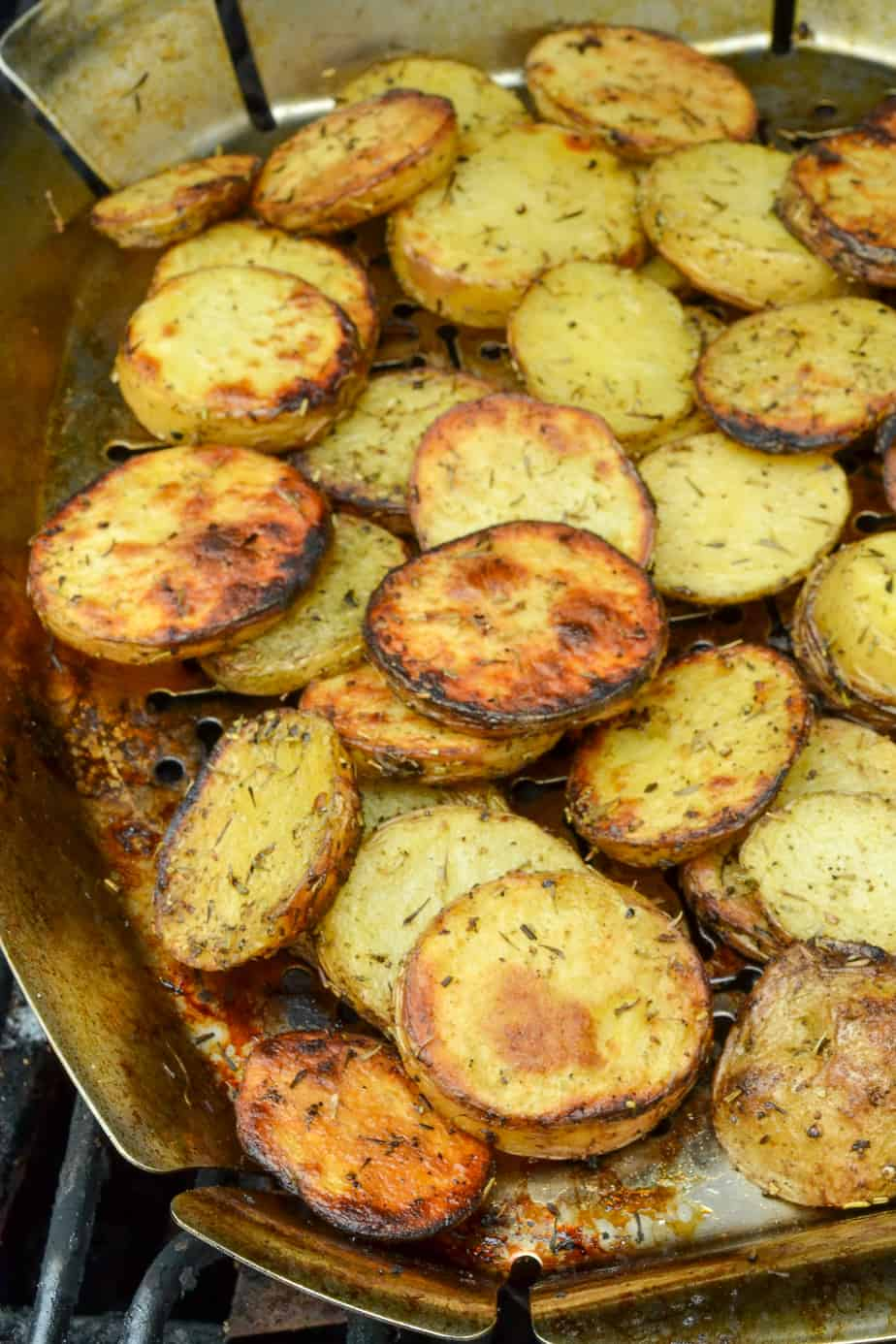 Grill basket full of herb potatoes