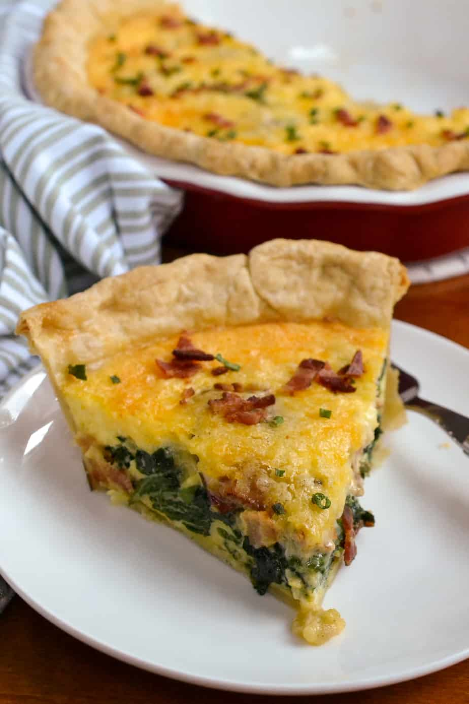 A slice of homemade spinach quiche.